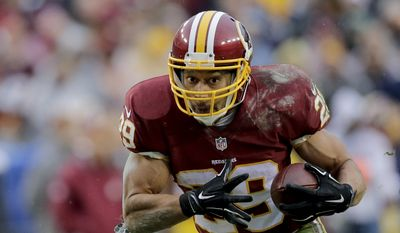 Washington Redskins running back Roy Helu (29) carries the ball during the second half of an NFL football game against the Dallas Cowboys in Landover, Md., Sunday, Dec. 28, 2014. (AP Photo/Mark Tenally)