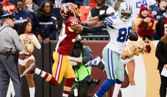 Dallas Cowboys wide receiver Dez Bryant (88) stiff arms Washington Redskins free safety E.J. Biggers (30) on his way to a 65 yard touchdown as the Washington Redskins play the Dallas Cowboys the at FedExField, Landover, Md., Sunday, December 28, 2014. (Andrew Harnik/The Washington Times)