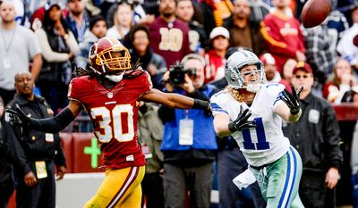 Dallas Cowboys wide receiver Cole Beasley (11) can't haul in a deep pass at the end of the first half as the Washington Redskins play the Dallas Cowboys the at FedExField, Landover, Md., Sunday, December 28, 2014. (Andrew Harnik/The Washington Times)