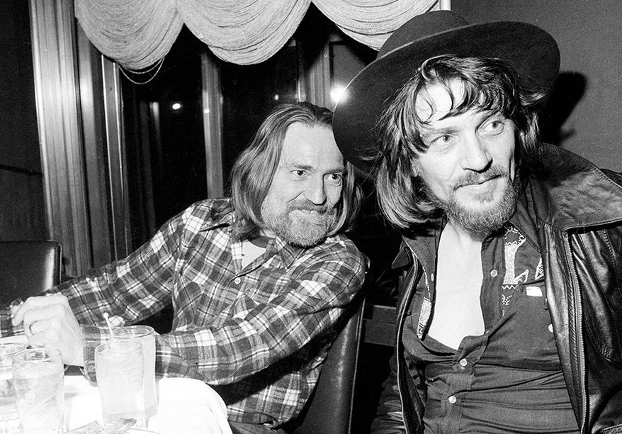 10. Mammas, Don't Let Your Babies Grow Up To Be Cowboys by Willie Nelson and Waylon Jennings -Country music singers Waylon Jennings, right, and Willie Nelson are shown at a party in New York City celebrating the recording of their new album, Feb. 5, 1978.  (AP Photo)