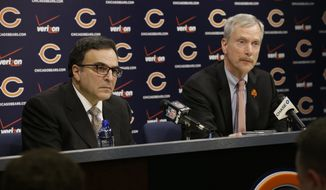 Chicago Bears President and CEO Ted Phillips, left, and Chairman George H. McCaskey listen to question at a news conference at Halas Hall on Monday, Dec. 29, 2014,  in Lake Forest, Ill. Chicago Bears head coach Marc Trestman and general manager Phil Emery were fired Monday after the team completed a disappointing 5-11 campaign.(AP Photo/Nam Y. Huh)