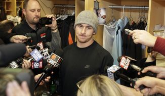 Cleveland Browns quarterback Johnny Manziel talks with the media at the NFL football team's training camp, Monday, Dec. 29, 2014, in Berea, Ohio.  Along with key injuries and late-game collapses, the Browns' seventh straight losing season was undermined by the antics of wide receiver Josh Gordon, Manziel and cornerback Justin Gilbert. Owner Jimmy Haslam promised the organization will weed out any problem players. (AP Photo/Tony Dejak)