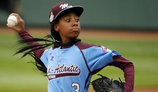 FILE - In this Aug. 15, 2014, file photo, Pennsylvania's Mo'ne Davis delivers in the fifth inning against Tennessee during a baseball game in United States pool play at the Little League World Series tournament in South Williamsport, Pa. Davis, who became an instant celebrity in August when she became the first girl to win a Little League World Series game, is The Associated Press 2014 Female Athlete of the Year. (AP Photo/Gene J. Puskar, File)