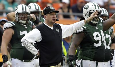 FILE- In this Dec. 29, 2013, file photo, New York Jets head coach Rex Ryan gestures on the sideline during the third quarter of an NFL football game against the Miami Dolphins in Miami Gardens, Fla. The New York Jets owner Woody Johnson fired Ryan on Monday, Dec. 29, 2014, one day after one of the most disappointing seasons in franchise history. (AP Photo/Lynne Sladky, File)