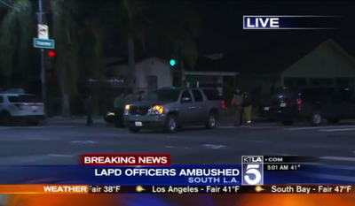 """Two Los Angeles police officers were shot at Sunday night while they drove their patrol car in what police are calling an """"unprovoked attack."""" (KTLA 5)"""