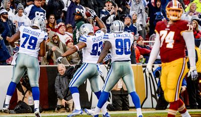 Dallas Cowboys defensive end Anthony Spencer (93) scores on a 5 yard touchdown recovery late in the fourth quarter as the Washington Redskins play the Dallas Cowboys the at FedExField, Landover, Md., Sunday, December 28, 2014. (Andrew Harnik/The Washington Times)