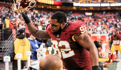 Washington Redskins nose tackle Chris Baker (92) slams his helmet on the bench in the final minutes of the game as the Washington Redskins play the Dallas Cowboys the at FedExField, Landover, Md., Sunday, December 28, 2014. (Andrew Harnik/The Washington Times)