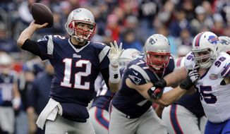 New England Patriots quarterback Tom Brady (12) passes against the rush by Buffalo Bills defensive tackle Kyle Williams (95) in the first half of an NFL football game, Sunday, Dec. 28, 2014, in Foxborough, Mass. (AP Photo/Charles Krupa)