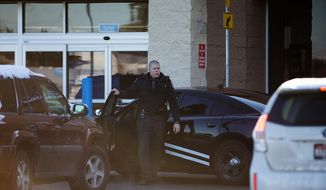 An Idaho State Patrol officer arrives at Wal-Mart in Hayden, Idaho, Tuesday, Dec. 30, 2014. A 2-year-old boy accidentally shot and killed his mother after he reached into her purse at the northern Idaho Wal-Mart and her concealed gun fired, authorities said Tuesday. (AP Photo/Coeur d'Alene Press, Tess Freeman) MANDATORY CREDIT