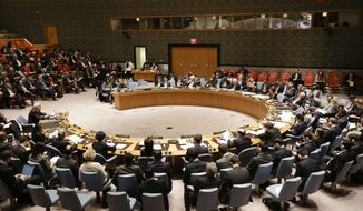 Members listen as Palestinian Ambassador to the United Nations Riyad Mansour, left, speaks during a meeting of the U.N. Security Council, Tuesday, Dec. 30, 2014, at the United Nations headquarters. The United Nations Security Council has rejected a Palestinian resolution demanding an end to Israeli occupation within three years on Tuesday. (AP Photo/Frank Franklin II)