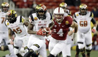 Maryland wide receiver Stefon Diggs is chased by Stanford linebacker Blake Martinez after a reception during the first half of the Foster Farms Bowl NCAA college football game Tuesday, Dec. 30, 2014, in Santa Clara, Calif. (AP Photo/Marcio Jose Sanchez)