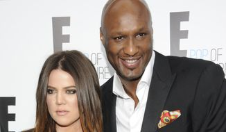 """Khloe Kardashian Odom and Lamar Odom from the show """"Keeping Up With The Kardashians"""" attend an E! Network upfront event at Gotham Hall on Monday, April 30, 2012, in New York.  Khloe filed for divorce from her husband of four years, citing """"irreconcilable differences"""" as the reason for the split.  (AP Photo/Evan Agostini) ** FILE **"""