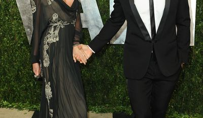 From left, model Miranda Kerr and actor Orlando Bloom arrive at the 2013 Vanity Fair Oscars Viewing and After Party on Sunday, Feb. 24 2013 at the Sunset Plaza Hotel in West Hollywood, Calif. (Photo by Jordan Strauss/Invision/AP)