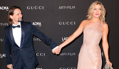 Matthew Bellamy, left, and Kate Hudson arrive at the LACMA Art + Film Gala at LACMA on Saturday, Nov. 1, 2014, in Los Angeles. After four years together, the couple called off their engagement. (Photo by Jordan Strauss/Invision/AP)