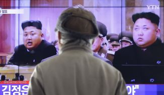 A man watches a TV news program showing North Korean leader Kim Jong-un, at the Seoul Railway Station in Seoul, South Korea, Thursday, Jan. 1, 2015. (AP Photo/Ahn Young-joon) ** FILE **