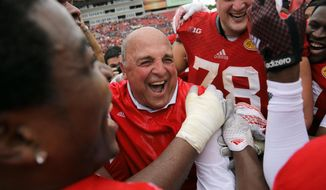 Wisconsin acting head coach Barry Alvarez laughs with his team after defeating Auburn 34-31 in overtime during the Outback Bowl NCAA college football game Thursday, Jan. 1, 2015, in Tampa, Fla. (AP Photo/Chris O'Meara)