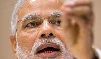 Critics accuse Indian Prime Minister Narendra Modi of favoring his own Hinduism over other religions. (Associated Press)