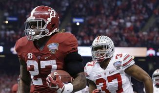 Alabama running back Derrick Henry (27) runs toward the end zone against Ohio State linebacker Joshua Perry (37) in the first half of the Sugar Bowl NCAA college football playoff semifinal game, Thursday, Jan. 1, 2015, in New Orleans. Henry scored a touchdown on the play. (AP Photo/Brynn Anderson)