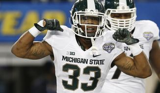 Michigan State running back Jeremy Langford (33) celebrates a touchdown during the first half of the Cotton Bowl NCAA college football game against Baylor, Thursday, Jan. 1, 2015, in Arlington, Texas. (AP Photo/Brandon Wade)