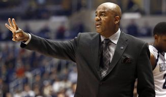 Georgetown head coach John Thompson III reacts in the first half of an NCAA college basketball game against Xavier, Wednesday, Dec. 31, 2014, in Cincinnati. (AP Photo/David Kohl)