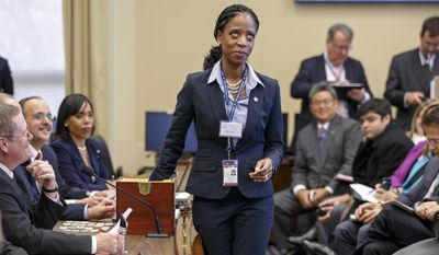 In this Nov. 19, 2014, file photo, Rep.-elect Mia Love, R-Utah reaches into a box to choose a number as newly elected House lawmakers take their chances at a lottery to determine who gets to go first in choosing their new office assignments, a Capitol Hill tradition for incoming freshmen, on Capitol Hill in Washington. Love, the first black Republican woman elected to Congress, is declining to say much about a controversy over a House Republican leader speaking to a white supremacist group 12 years ago. (AP Photo/J. Scott Applewhite, File)