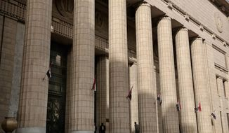 A man enters the high court ahead of a hearing for three Al-Jazeera English journalists in Cairo, Egypt, Thursday, Jan. 1, 2015. (AP Photo/Nariman El-Mofty) ** FILE **