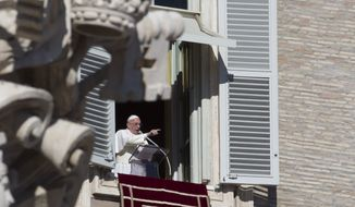 Pope Francis delivers his speech during the Angelus noon prayer he delivered from the window of his studio overlooking St. Peter's Square at the Vatican, Thursday, Jan. 1, 2015. (AP Photo/Andrew Medichini)