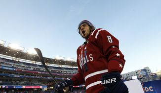 Washington Capitals left wing Alex Ovechkin (8), from Russia, celebrates as he leaves the rink after the Winter Classic outdoor NHL hockey game against the Chicago Blackhawks at Nationals Park, Thursday, Jan. 1, 2015, in Washington. The Capitals won 3-2. (AP Photo/Alex Brandon)