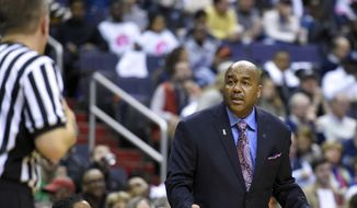 Georgetown head coach John Thompson III, right, gestures towards an official during the second half of an NCAA college basketball game against Creighton, Saturday, Jan. 3, 2015, in Washington. Georgetown won 76-61. (AP Photo/Nick Wass)