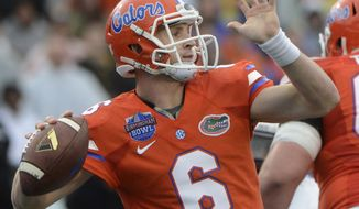 Florida quarterback Jeff Driskel (6) throws a pass during the first half of the Birmingham Bowl NCAA college football game against East Carolina, Saturday, Jan. 3, 2015, in Birmingham, Ala. (AP Photo/ AL.com, Mark Almond)