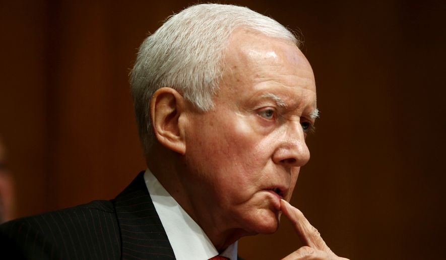 FILE - In this May 21, 2013 file photo, Sen. Orrin Hatch of Utah listens on Capitol Hill in Washington. Republican senators poised to lead major committees when the GOP takes charge are intent on pushing back many of President Barack Obama's policies, setting up potential showdowns over environmental rules, financial regulations and national security. (AP Photo/Charles Dharapak, File)
