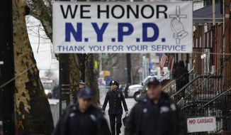 Police officers arrive to the funeral of Officer Wenjian Liu in the Brooklyn borough of New York, Sunday, Jan. 4, 2015. Liu and his partner, officer Rafael Ramos, were killed Dec. 20, 2014, as they sat in their patrol car on a Brooklyn street. The shooter, Ismaaiyl Brinsley, later killed himself. (AP Photo/Seth Wenig) ** FILE **
