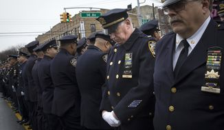 Some police officers turn their backs as Mayor Bill de Blasio speaks during the funeral of New York Police Department Officer Wenjian Liu at Aievoli Funeral Home, Sunday, Jan. 4, 2015, in the Brooklyn borough of New York. Liu and his partner, officer Rafael Ramos, were killed Dec. 20 as they sat in their patrol car on a Brooklyn street. The shooter, Ismaaiyl Brinsley, later killed himself. (AP Photo/John Minchillo)