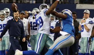 Dallas Cowboys outside linebacker Anthony Hitchens (59) is hit in the back by a pass from Detroit Lions quarterback Matthew Stafford (9), intended for Detroit Lions tight end Brandon Pettigrew (87), during the fourth quarter of an NFL wildcard playoff football game, Sunday, Jan. 4, 2015, in Arlington, Texas. (AP Photo/The Fort Worth Star-Telegram, Paul Moseley)  MAGS OUT; (FORT WORTH WEEKLY, 360 WEST); INTERNET OUT