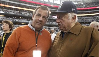 New Jersey Gov. Chris Christie and former Los Angeles Dodgers manager Tommy Lasorda talk on the sideline before an NFL wildcard playoff football game between the Dallas Cowboys and the Detroit Lions, Sunday, Jan. 4, 2015, in Arlington, Texas. (AP Photo/Brandon Wade)