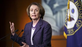 House Minority Leader Nancy Pelosi of California speaks with reporters on Capitol Hill in Washington on Dec. 5, 2014. (Associated Press) **FILE**