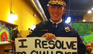 Pittsburgh Police Chief Cameron McLay is facing criticism for a photo circulating on social media that shows him holding a sign promoting the hashtag #EndWhiteSilence during the city's First Night parade. (Facebook/Fight Back Pittsburgh)