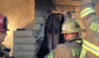 Riverside County firefighters reportedly spent two hours Saturday morning rescuing a naked woman who had gotten stuck in her ex-boyfriend's chimney. (Twitter/Riverside County Fire Department/Jared Hazelaar)