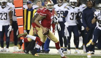 San Francisco 49 ers  Quarterback Colin Kaepernick  #7 during the first quarter in the game against the San Diego Chargers  at Levis Stadium during an NFL game in Santa Clara, Calif. on Sunday, Dec. 20 , 2014. (AP Photo/David Seelig)
