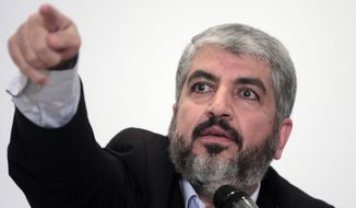 Khaled Meshaal, head of Hamas Politburo in Damascus, talks during a presser following his talks with Egyptian officials  in Cairo, Egypt., in this Sept. 28, 2009, file photo. The Hamas militant group is denying claims Tuesday, Jan. 6, 2015 that its exiled leader, Khaled Mashaal, has been expelled from his base in Qatar. (AP Photo/Amr Nabil, File)