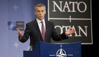 In this Tuesday, Dec. 2, 2014 file photo, NATO Secretary General Jens Stoltenberg gestures while speaking during a media conference prior to a meeting of the North Atlantic Council at NATO headquarters in Brussels. Leaving combat operations in Afghanistan behind, NATO is shifting its focus to Europe in 2015 and the creation of its new ultra-rapid reaction force, designed as a deterrent to Russia.  (AP Photo/Virginia Mayo, File)
