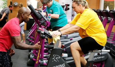 """Dolvett Quince (left) with Lori Harrigan-Mack from """"The Biggest Loser."""" Many people watch the top-rated reality show for weight loss ideas and inspiration. (NBC)"""
