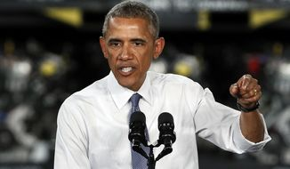 President Barack Obama speaks at the Ford Michigan Assembly Plant in Wayne, Mich., Wednesday, Jan. 7, 2015.  Calling the 2009 federal auto bailout a success story, Obama touted steps taken by his administration that he said have brought the economy and U.S. manufacturing roaring back to life. (AP Photo/Paul Sancya)