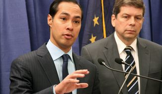 U.S. Housing and Urban Development Secretary Julian Castro (left) announces that nearly $60 million in grants have been awarded to tribal communities across the nation during a news conference Oct. 6 in Anchorage, Alaska. Sen. Mark Begich, Alaska Democrat, listens at right. (Associated Press)