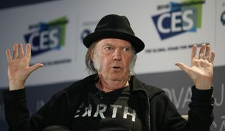 Musician Neil Young speaks during a session at the International CES Wednesday, Jan. 7, 2015, in Las Vegas. (AP Photo/John Locher) ** FILE **