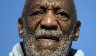 Bill Cosby jokingly warned a woman in the audience during a show in Canada Thursday night to be careful drinking around him. (Associated Press)