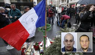 """A French flag flutters after being erected with flowers outside the Charlie Hebdo newspaper in Paris, Thursday, Jan.8, 2015, a day after masked gunmen stormed the offices of a satirical newspaper and killed 12 people. Protesters in some U.S. cities — repeating the viral online slogan """"Je Suis Charlie"""" or """"I Am Charlie""""; demonstrated against the deadly terror attack on a Paris newspaper office, joining thousands around the world who took to the streets to rally against the killings. (Inset) the suspects Cherif, left, and Said Kouachi  in the newspaper attack. (AP Photo/Francois Mori)"""