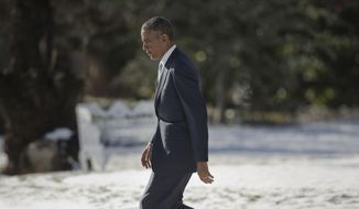 President Barack Obama walks across the South Lawn of the White House in Washington, Friday, Jan. 9, 2015, before his departure on Marine One to Andrews Air Force Base, Md. Obama traveled to Knoxville, Tenn., to formally announce his plan for a tuition-free Community College at an event at Pellissippi State Community College. (AP Photo/Pablo Martinez Monsivais) ** FILE **