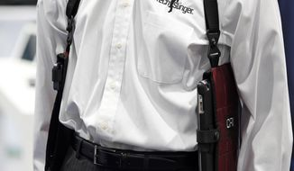 The TechSling smart device holster is displayed at the Tech Slinger booth during the International CES, Thursday, Jan. 8, 2015, in Las Vegas. (AP Photo/John Locher)