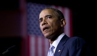 President Barack Obama speaks about the France newspaper attack, Friday, Jan. 9, 2015, at Pellissippi State Community College in Knoxville, Tenn. (AP Photo/Carolyn Kaster)